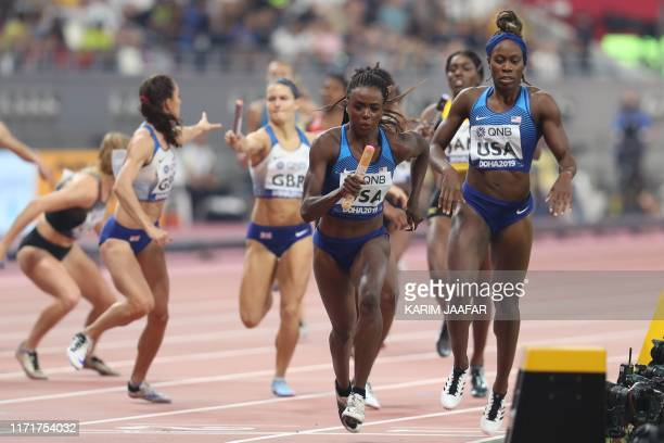 USA's Jasmine Blocker receives the baton from teammate Jessica Beard in the Mixed 4 x 400m Relay heats at the 2019 IAAF World Athletics Championships...