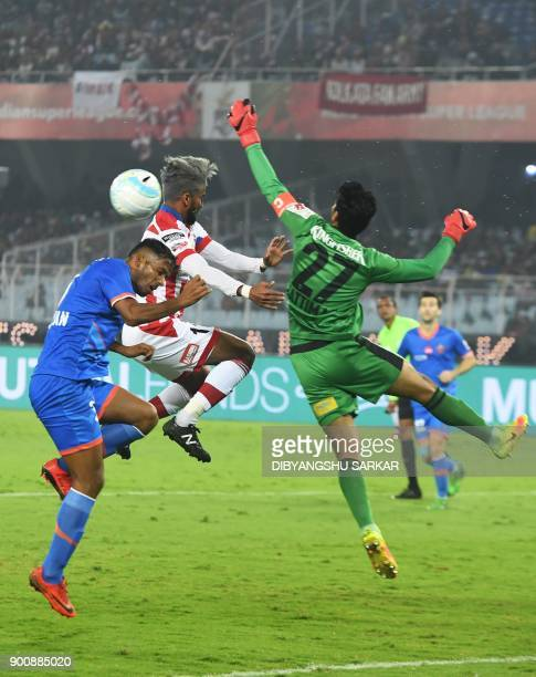 ATK's Jayesh Rane vies with FC Goa's Laxmikant Kattimani during the Indian Super League football match between ATK and FC Goa at the Vivekananda Yuba...