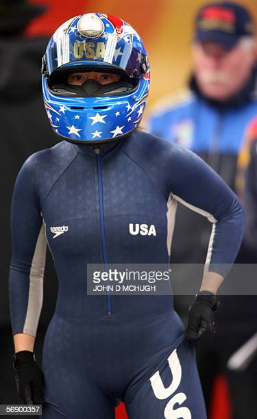 US's Jean Prahim hitches her suit prior to the start of the third run of the women's bobsleigh event at the Turin 2006 Winter Olympics in Cesana...
