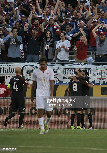 USA's Jermaine Jones and USA's Clint Dempsey celebrate a goal against Costa Rica during a Copa America Centenario football match in Chicago Illinois...