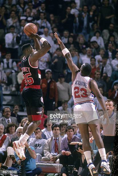 DETROIT MI CIRCA 1980's Jerome Kersey of the Portland Trailblazers in action shooting over Mark Aguirre during a late circa 1980's NBA basketball...