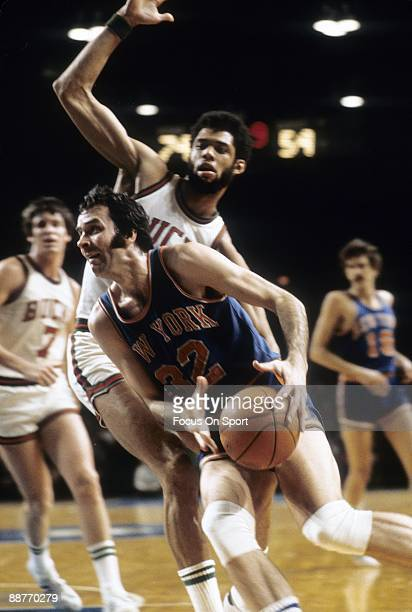 S: Jerry Lucas of the New York Knickerbockers in action guarded closely by Kareem Abdul-Jabbar of the Milwaukee Bucks during an early circa 1970's...
