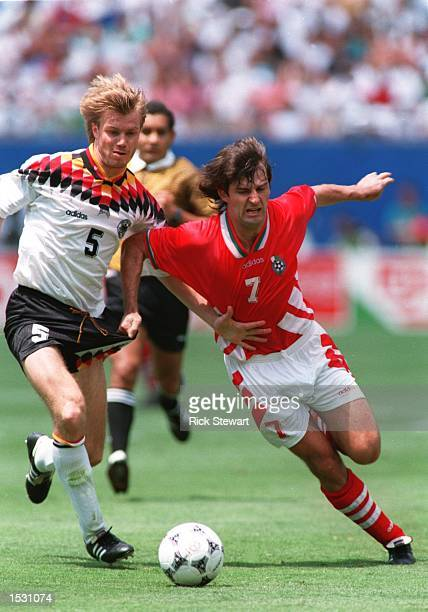 ANOTHER's JERSEYS WHILE BATTLING FOR POSSESION OF THE BALL DURING BULGARIA's 21 VICTOREY OVER GERMANY IN THE QUARTER FINALS OF THE 1994 WORLD CUP AT...