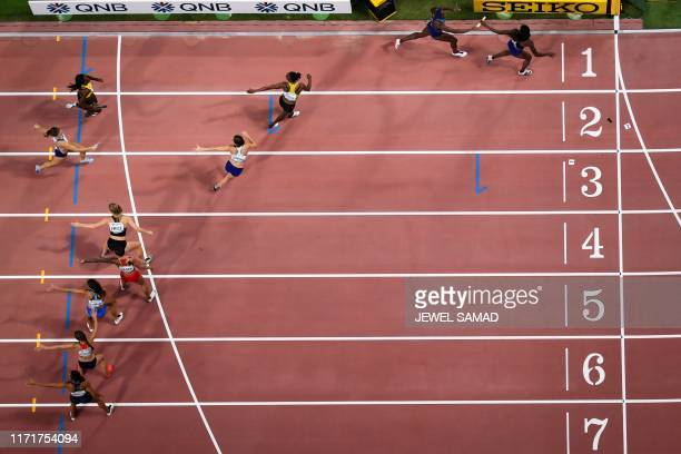 USA's Jessica Beard passes to USA's Jasmine Blocker in the Mixed 4 x 400m Relay heats at the 2019 IAAF World Athletics Championships at the Khalifa...