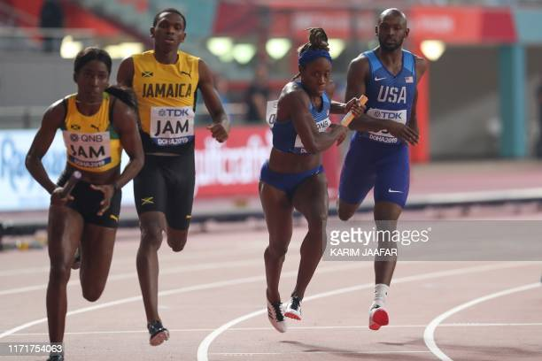 USA's Jessica Beard receives the baton from USA's Tyrell Richard in the Mixed 4 x 400m Relay heats at the 2019 IAAF World Athletics Championships at...