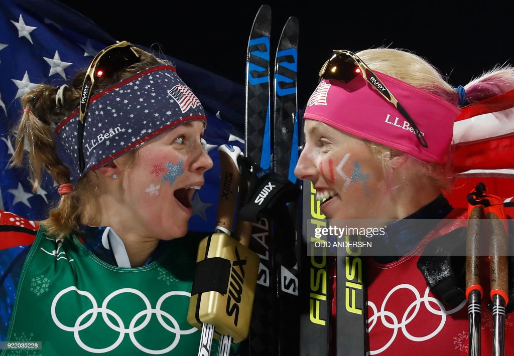 TOPSHOT - USA's Jessica Diggins (L) and USA's Kikkan Randall celebrate winning gold in the women's cross country team sprint free final at the Alpensia cross country ski centre during the Pyeongchang 2018 Winter Olympic Games on February 21, 2018 in Pyeongchang. / AFP PHOTO / Odd ANDERSEN