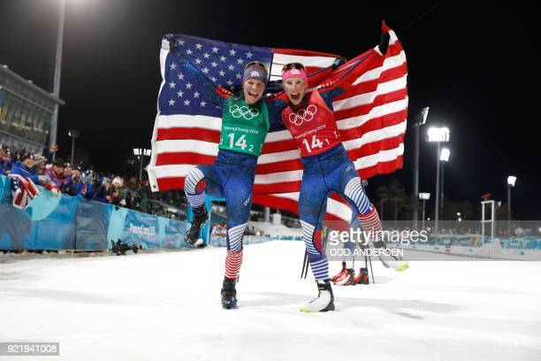 USA's Jessica Diggins and USA's Kikkan Randall react after winning gold in the women's cross country team sprint free final at the Alpensia cross...