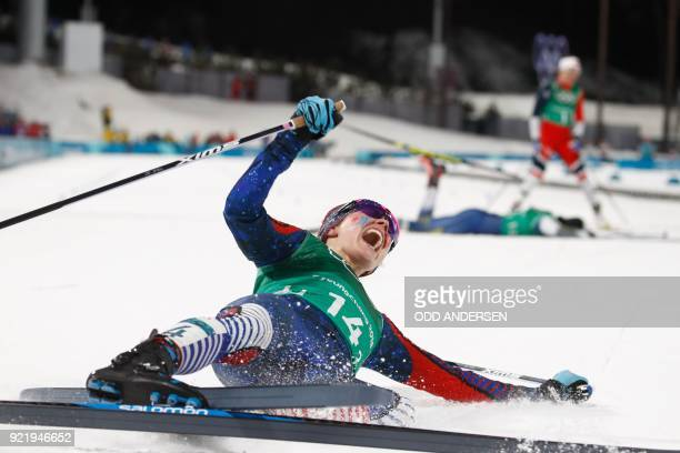 TOPSHOT USA's Jessica Diggins reacts as she crosses the finish line to win team gold in the women's cross country team sprint free final at the...