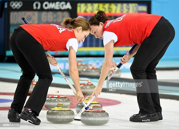 USA's Jessica Schultz left and Ann Swisshelm guide a stone during women's curling competition against China at the Ice Cube Curling Centre during the...