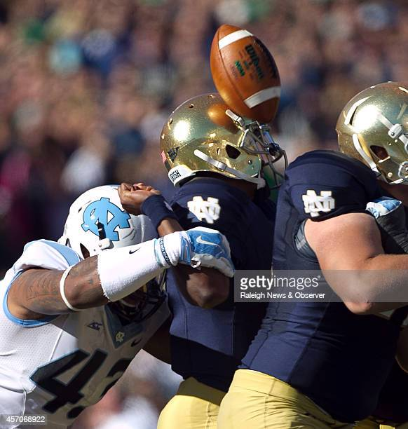 UNC's Jessie Rogers forces Notre Dame quarterback Everett Golson to fumble in the first quarter leading to UNC's first touchdown on Saturday Oct 11...