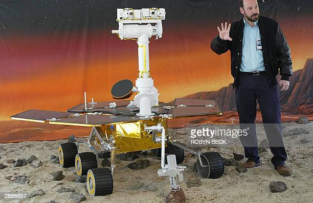 NASA's Jet Propulsion Laboratory Navigator Program Engineer Dr Randii Wessen discusses the Mars Exploration Rover beside a model of the MER in a...