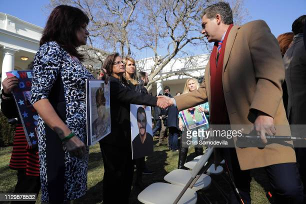 CNN's Jim Acosta greets 'angel moms' including Agnes Gibboney following a news conference with US President Donald Trump in the Rose Garden at the...