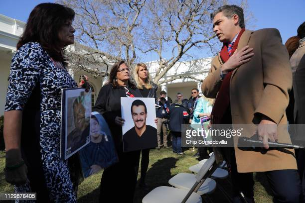 CNN's Jim Acosta talks with 'Angel moms' including Sabine Durden following a news conference with US President Donald Trump in the Rose Garden at the...