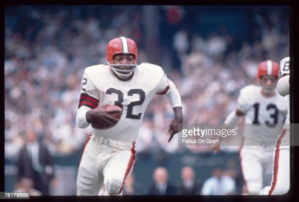 CIRCA 1950's Jim Brown of the Cleveland Browns carries the ball in a late circa 1950's NFL football game Brown played for the Browns from 19571965