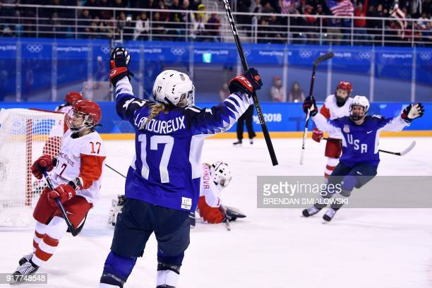 TOPSHOT USA's Jocelyne LamoureuxDavidson celebrates her goal in the women's preliminary round ice hockey match between the US and Olympic Athletes...