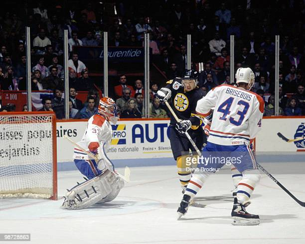 MONTREAL 1990's Joe Juneau of the Boston Bruins skates against the Montreal Canadiens in the early 1990's at the Montreal Forum in Montreal Quebec...