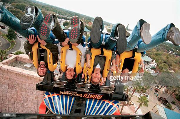 ''N SYNC''s Joey Fatone 'JC' Chasez Lance Bass and their assistant Beth Flanagan ride Busch Gardens Tampa Bay''s Montu January 27 2001 in Tampa FL
