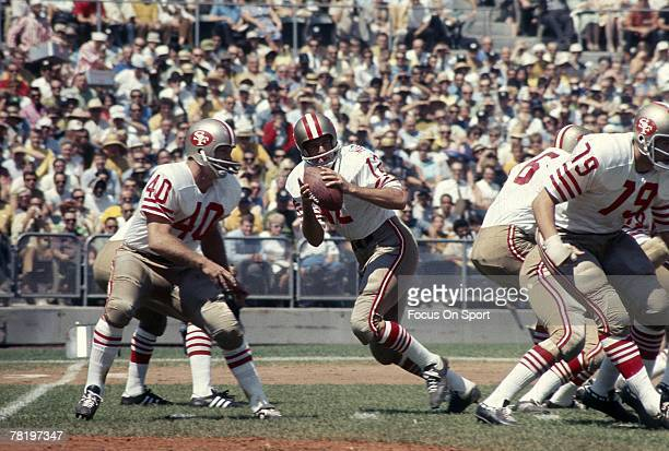 CIRCA 1960's John Brodie of San Franicisco 49ers drops back to pass during a mid circa 1960's NFL football game Brode played for the 49ers from 195773