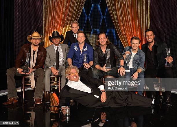 CMT's John Hamlin Jason Aldean Tim McGraw Florida Georgia Line Hunter Hayes Luke Bryan and Ron White gather on stage after the CMT Artists Of The...