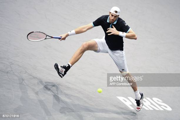 S John Isner returns the ball to Serbia's Filip Krajinovic during the semi-final round at the ATP World Tour Masters 1000 indoor tennis tournament on...