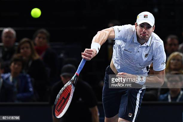 USA's John Isner serves the ball to Britain's Andy Murray during their final tennis match at the ATP World Tour Masters 1000 indoor tournament in...