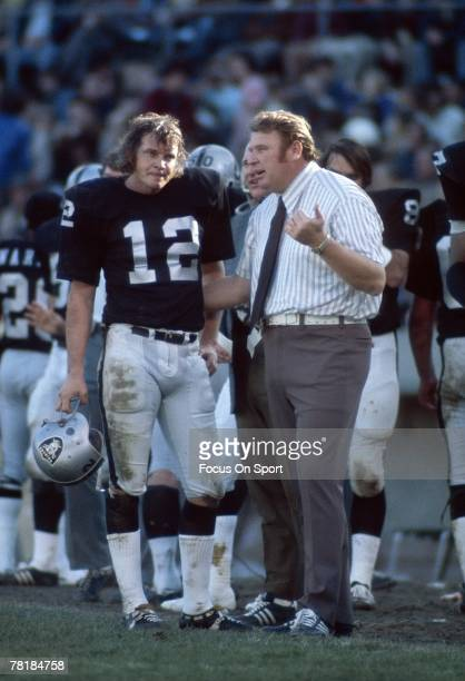 OAKLAND CA CIRCA 1970's John Madden head coach of the Oakland Raiders talks to his quarterback Ken Stabler from the sideline during a mid circa 1970s...