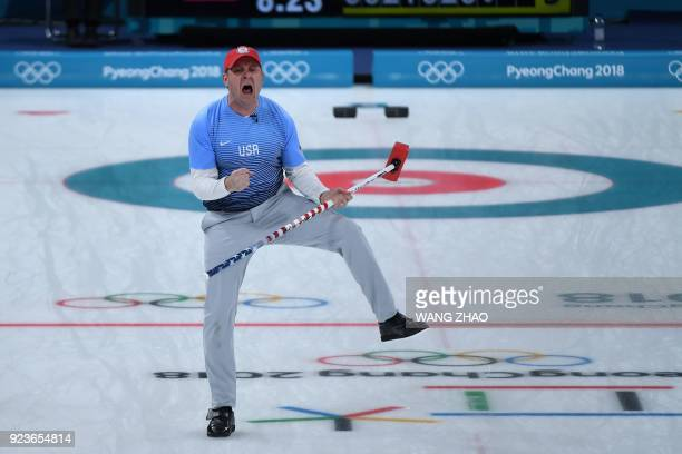 TOPSHOT USA's John Shuster celebrates a point during the curling men's gold medal game between the USA and Sweden during the Pyeongchang 2018 Winter...