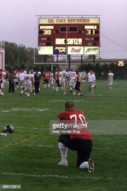CSUN's Johnny Acosta No 70 watches as the Idaho State football team celebrates their 30–31 overtime win Saturday afternoon September 30 2000 in...