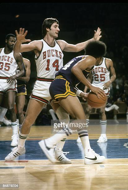 S: Jon McGlocklin of Milwaukee Bucks in action playing tight defense during a early circa 1970's NBA basketball game at the Milwaukee Arena in...