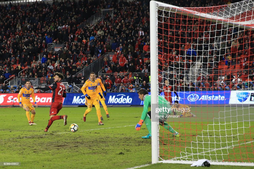 CONCACAF TFC's Jonathan Osorio scores the winner and gets the ball past Club Tigres goal keeper Nahuel Guzman in the second half BMO in Toronto , March 7, 2018.