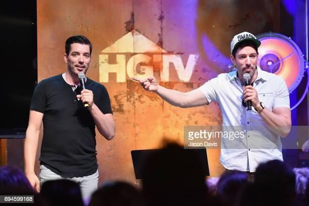 HGTV's Jonathan Scott and Drew Scott speak onstage at the HGTV Lodge during CMA Music Fest on June 10 2017 in Nashville Tennessee
