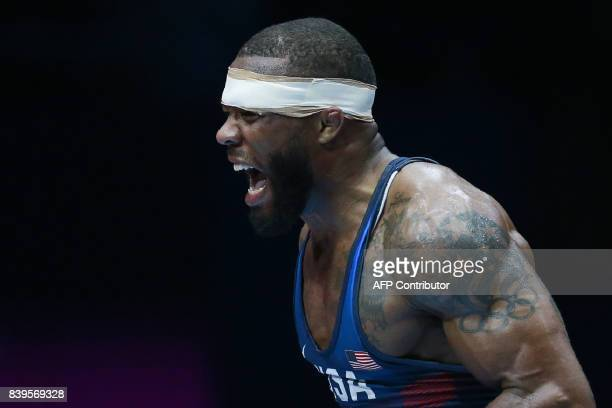 USA's Jordan Burroughs celebrates after winning the men's freestyle wrestling 74kg category final at the FILA World Wrestling Championships in Paris...