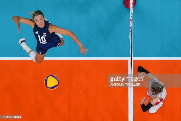 S Jordan Larson spikes the ball in the women's semi-final volleyball match between USA and Serbia during the Tokyo 2020 Olympic Games at Ariake Arena...
