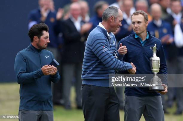 USA's Jordan Spieth celebrates with the Claret Jug after winning The Open Championship 2017 with USA's Matt Kuchar and England's Alfie Plant at Royal...