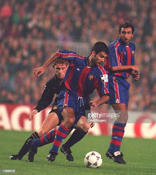 BARCELONA's JOSEP GUARDIOLA TURNS NICKY BUTT OF MANCHESTR UTD DURING THE CHAMPIONS LEAGUE MATCH AT THE NOU CAMP STADIUM IN BARCELONA SPAIN Mandatory...