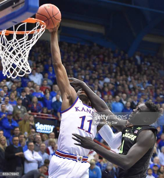 KU's Josh Jackson takes one across his face from Baylor's Jo LualAcuil as he drives to the basket during the first half on Wednesday Feb 1 at Allen...