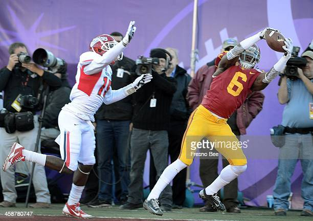 USC's Josh Shaw comes up with an interception in the end zone as Fresno State's Davante Adams can't make the play in the Royal Purple Las Vegas Bowl...