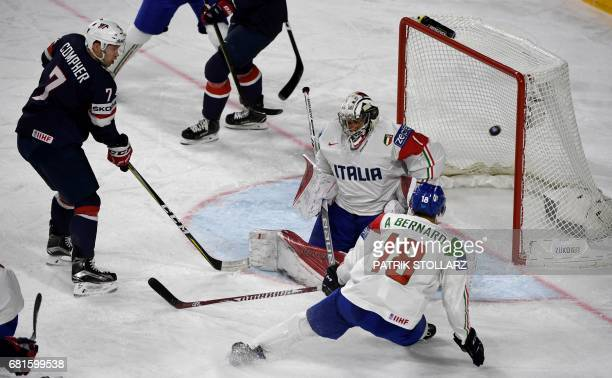 USA´s JT Comper scores past Italy´s goalkeeper Andreas Bernard during the IIHF Ice Hockey World Championships first round match between USA and Italy...