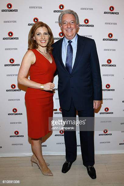 CNBC's Julia Boorstin and IPG Chairman and CEO Michael Roth pose before the The Chairman's Desk Michael Roth panel on the Times Center Stage during...