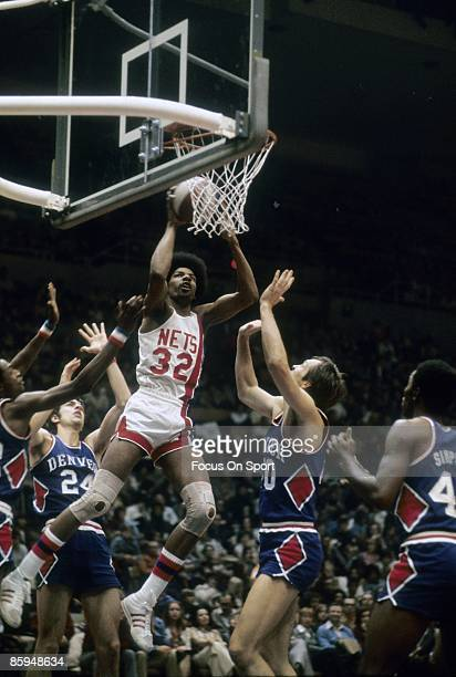 S: Julius Eving of the New Jersey Nets in action against the Denver Nuggets during a mid circa 1970's NBA basketball game at the Rutgers Athletic...