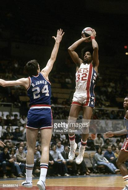 S: Julius Eving of the New Jersey Nets shoots over Bobby Jones of the Philadelphia 76ers during a mid circa 1970's NBA basketball game at the Rutgers...