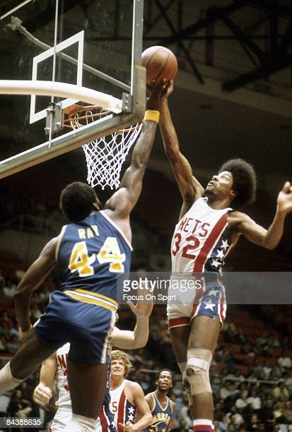 PISCATAWAY NJ CIRCA 1970's Julius Eving of the New Jersey Nets shoots over Clifford Ray of the Golden State Warriors during a mid circa 1970's NBA...