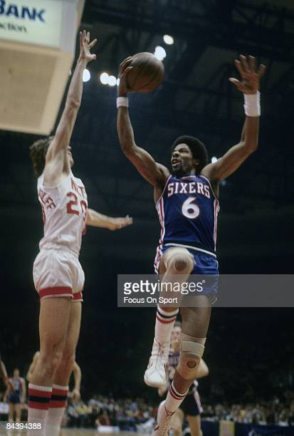 PISCATAWAY NJ CIRCA 1970's Julius Eving of the Philadelphia 76ers shoots against the New Jersey Nets during a late circa 1970's NBA basketball game...