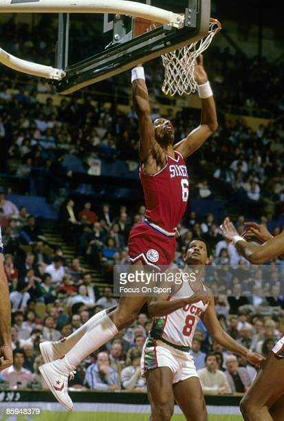 S: Julius Eving of the Philadelphia 76ers shoots over Marques Johnson of the Milwaukee Bucks during a mid circa 1980's NBA basketball game at the...