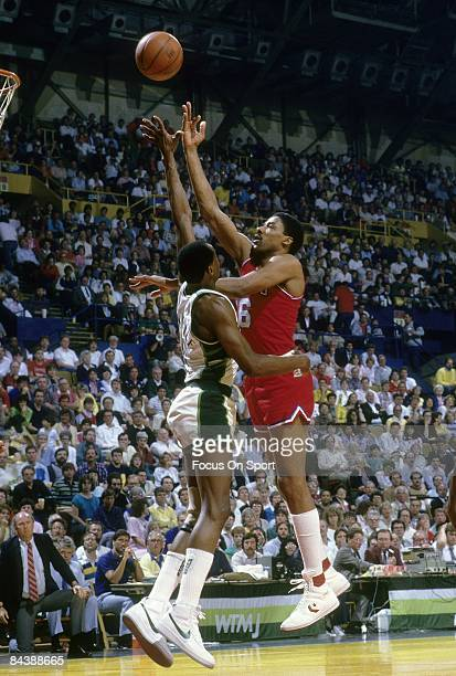 S: Julius Eving of the Philadelphia 76ers shoots over Sidney Moncrief of the Milwaukee Bucks during a mid circa 1980's NBA basketball game at the...