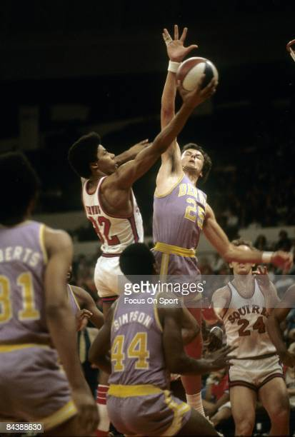 NORFOLK VA CIRCA 1970's Julius Eving of the Virginia Squires shoots over Paul Robisch of the Denver Rockets during an early circa 1970's ABA...