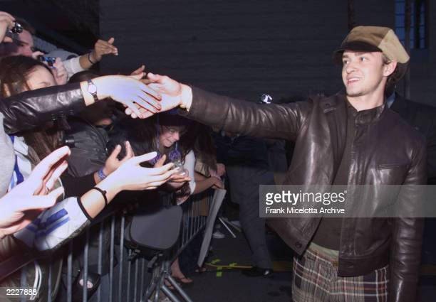 N' SYNC's Justin Timberlake greets fans before the 2001 Billboard Music Awards held at the MGM Grand Hotel Casino in Las Vegas NV Tuesday Dec 4 2001
