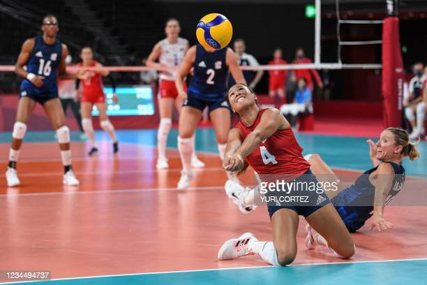 S Justine Wong-Orantes hits the ball in the women's semi-final volleyball match between USA and Serbia during the Tokyo 2020 Olympic Games at Ariake...
