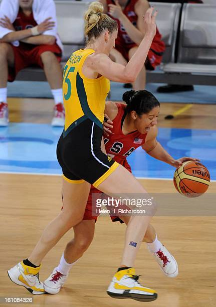 USA's Kara Lawson right keeps the ball away from Australia's Lauren Jackson #15 right The US women's basketball team claimed its fourth consecutive...