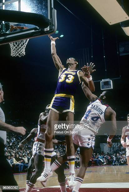 BALTIMORE MD CIRCA 1980's Kareem AbdulJabbar of the Los Angeles Lakers goes up for a rebound over Rick Mahorn of the Capital Bullets during a circa...